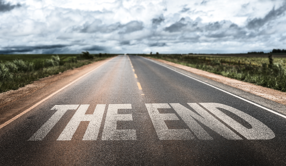 The End written on rural road-1